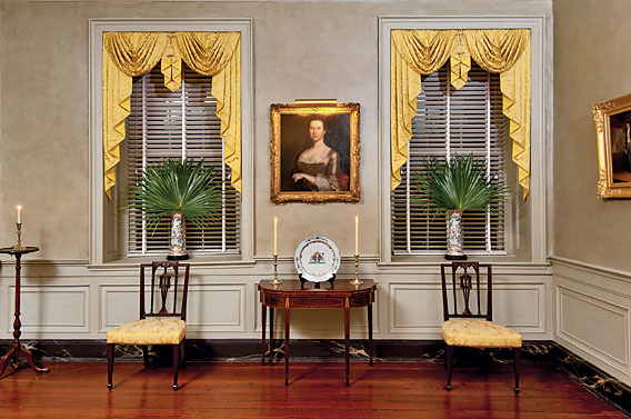 "Palmetto leaves, a characteristic of the South, center a portrait of Sarah Lock Chew (1721–1791), by John Hesselius (1728–1778), inscribed on the back ""Sarah Chew/Aetat 41/J. Hesselius pinx 1762."" A portrait of Sarah's son Samuel Lloyd Chew is in the collection of MESDA, and a portrait of her daughter Elizabeth Chew Smith hangs in the Brooklyn Museum. The wife purchased the card table with Prince-of-Wales inlay because it related to the square-back New York side chairs with carved Prince-of-Wales feathers. The unifying of such elements throughout the collection creates vignettes and an overall harmonious aesthetic."