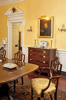 The portrait is of Frederick Perry Dutton and dated 1857. It hangs above a Federal chest of drawers attributed to New Brunswick, New Jersey, furniture maker Matthew Egerton.