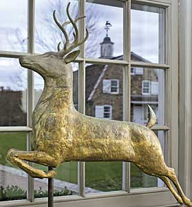 The leaping stag weathervane by J. W. Fiske of New York mimics the stag vane on the cupola of the guest barn. The barn was designed to reproduce a New Jersey stone barn with Dutch gambrel roof.