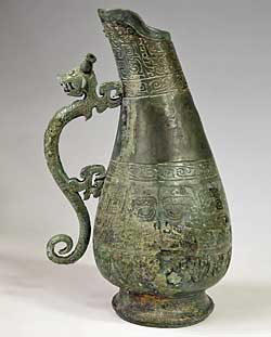 Hu Ewer with Dragon-shaped Handle, Bent Neck, and Beast-mask Design 1990 Western Zhou (ca. 1050–771 BCE) or Spring and Autumn period (770–476 BCE) Bronze. H 14.96, Diam 2.95 (at mouth), Diam. (at bottom) 4.53 in Unearthed in 1990 at Feixian Bridge, Xinning Xinning County Cultural Relics Administration