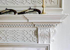 Fig. 9: The fine carving on this cypress mantel and overmantel in the John Fullerton House is in the second-floor drawing room, the most formal space for entertaining. Charleston was blessed with an influx of highly skilled craftspeople in the eighteenth century, all of whom contributed to the rich legacy of architecture, interior finishes, and decorative arts. Photography by Carrie Naas.