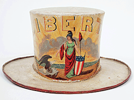 Fig. 5: Fireman's parade hat for the Liberty Company, containing labels of hatmaker Joshua Van Sant, and painter Geo. J. Roche and Son. Baltimore, 1820–1835. Painted pressed felt. H. 6-1/2, Diam. Brim 12 in.