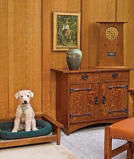 Wynn, the resident Lakeland terrier, has her own Arts and Crafts-style bed in the master bedroom in the new glass wing. The Rookwood vase, decorated by Louise Abel Barrett in 1924, is on a cabinet by Gustav Stickley. The painting of a boy picking berries is by Philadelphia artist Violet Oakley (1874–1961).